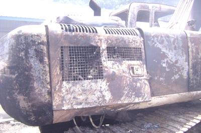 Bagian mesin beko terbakar